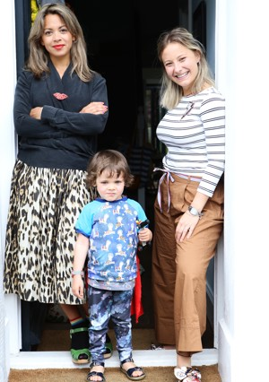 Kristal, her colleague and son Ziggy stand on a doorstep together
