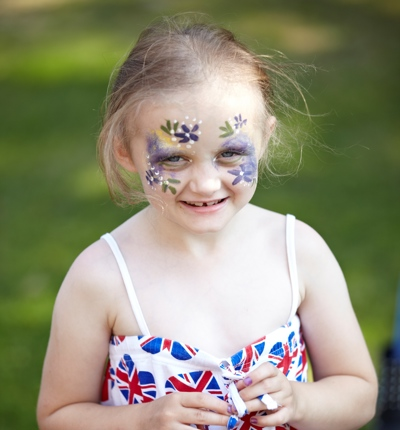 Lottie looking into the camera with facepaint on