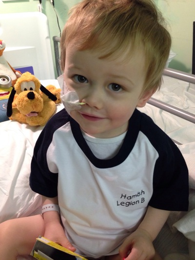 Hamish sat up on his hospital bed