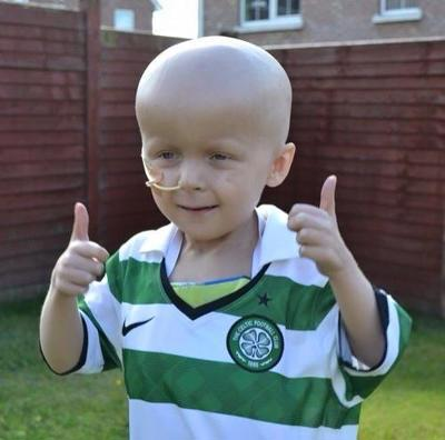 Thumbs up from Oscar as he wears a Celtic shirt