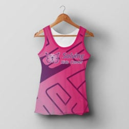 Image of pink solving kids cancer running vest on a hanger