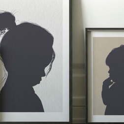 3 metallic portraits leaning against a white wall